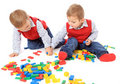 Twin brothers playing with blocks Stock Photography