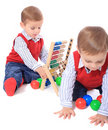 Twin brothers playing with toys Stock Images