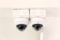 Twin cctv security camera on ceiling Royalty Free Stock Image