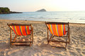 Twin deck chairs on the beach Royalty Free Stock Photo
