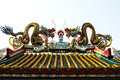 Twin dragons on the roof of chinese temple statue Stock Photo