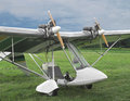 Twin engine ultralight aircraft close up of a open cockpit sitting on the ground in a field of grass Stock Images