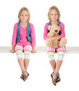 Twin girl with teddy bear on white Royalty Free Stock Photography
