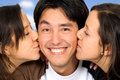Twin girls kissing a guy Royalty Free Stock Images