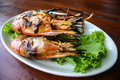Twin grilled shrimps on the dish Royalty Free Stock Photo