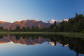 Twin Peaks reflect in the beautiful Lake Matheson at sunset, New Royalty Free Stock Photo