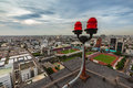 Twin red obstruction lights on the rooftop with city view in the background Stock Photos