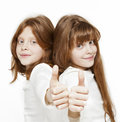 Twin sisters two girls twins isolated on the white Royalty Free Stock Photos