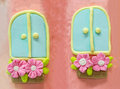 Twin sugar windows with pink blossom in pots Royalty Free Stock Photo