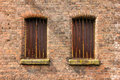 Twin windows in storehouse Stock Photos