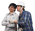 Twin workers looking at details of their work Royalty Free Stock Photo