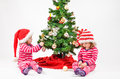 Twins and a christmas tree twin babies decorating Royalty Free Stock Images