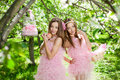 Twins in pink doll style Stock Photo