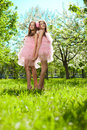 Twins in pink doll style Stock Images