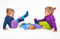 Twins playing with doll babies Stock Photo