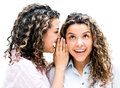 Twins telling a secret isolated over white background Stock Images