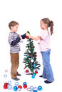 Twins and xmas tree Stock Image