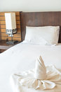 Twist towel on bed in room Royalty Free Stock Photography
