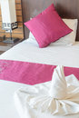 Twist towel and pillow on bed Royalty Free Stock Photos