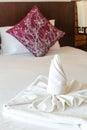 Twist towel put on bed Stock Photos