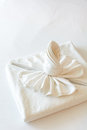 Twist towel put on bed Stock Images