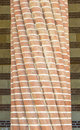 Twisted brick plated column with decorative bricks architectural detail Royalty Free Stock Photo
