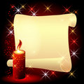 Twisted parchment and a burning candle Royalty Free Stock Photo