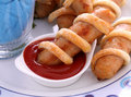 Twisted Pastry Sausages Stock Image