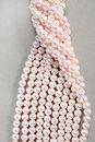 Twisted strands of pink pearls Stock Image