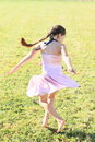 Twisting little girl Royalty Free Stock Photo