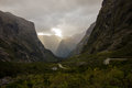 Twisty Road to Milford Sound Surrounded by Mountains Royalty Free Stock Photo