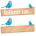 Twitter Bird with Follow Us sign Royalty Free Stock Photos