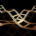 Two 3d golden film strip Royalty Free Stock Photo