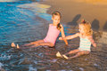 Two adorable kids playing in the sea on a beach happy Royalty Free Stock Image