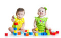 Two adorable kids playing with toys. Toddlers girl