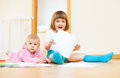 Two adorable siblings  with paper Stock Images