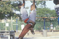 Two African-American children playing on playground equipment in Chicago, IL Royalty Free Stock Photo