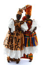 Two african dolls wearing boubou traditional costumes called Stock Photos