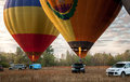 Two air balloons taking off in field at sunrise Royalty Free Stock Photo