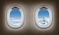 Two airplane windows. Jet interior. Royalty Free Stock Photo