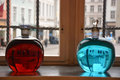 Two alchemical bottles with red and blue liquid Stock Image