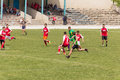 Two amateur football teams play on the field in outlying district of republic of moldova Royalty Free Stock Image