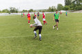 Two amateur football teams play on the field in outlying district of republic of moldova Royalty Free Stock Photo