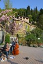Two amateur musicians playing jazz music in varenna italy – april are for fun a the port of at the lake como a beautiful Royalty Free Stock Photos