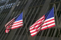 Two american flags in front of new york stock exchange on wall street new york city new york Royalty Free Stock Photography