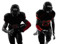 Two american football players running silhouette in shadow on white background Royalty Free Stock Image