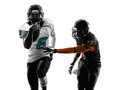 Two american football players running silhouette in shadow on white background Royalty Free Stock Photo