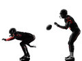 Two american football players on scrimmage silhouette in shadow white background Royalty Free Stock Images