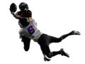 Two american football players tackle silhouette in shadow on white background Royalty Free Stock Photography