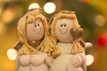 Two angels pair of over bokeh background on christmas Stock Image